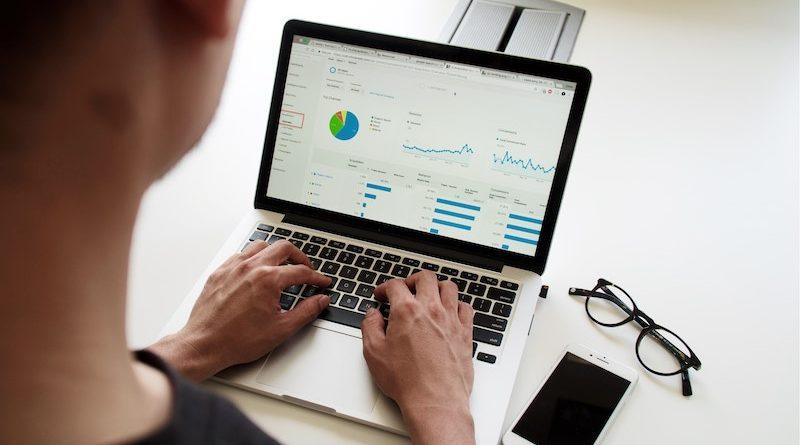 Image of women working on data