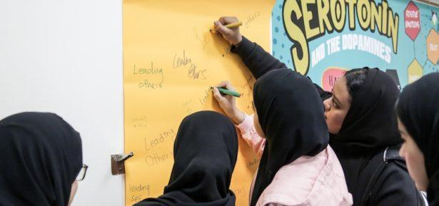 Girls writing on white board image