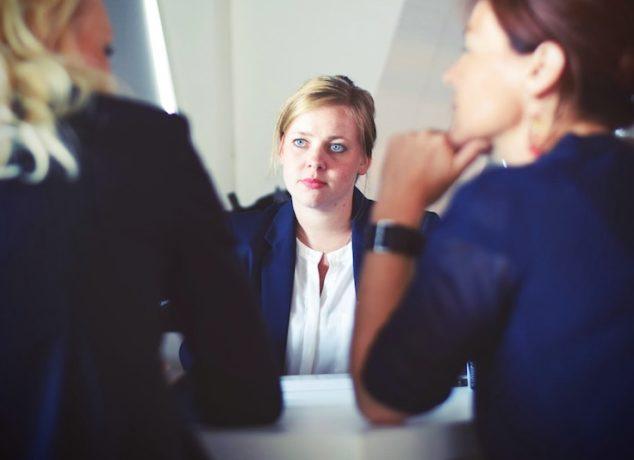 girls talking in a meeting